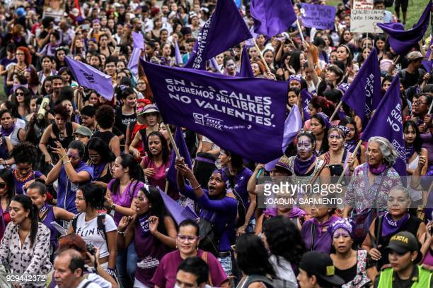 Women chant slogans as they march during the commemoration of the International Women's Day in Medellin Colombia on March 8 2018 / AFP PHOTO /...