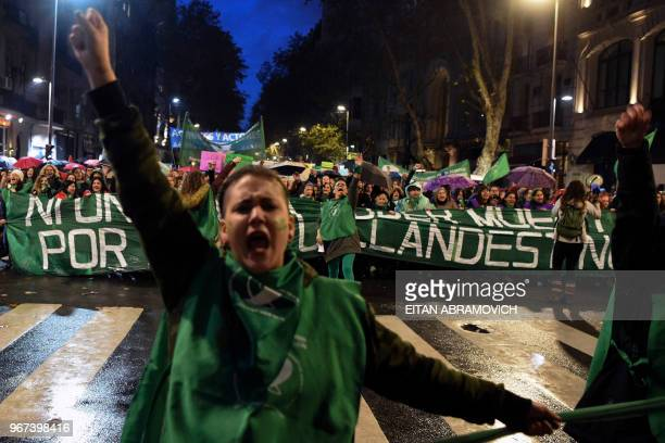 Women chant slogans as they take part in a march called by the movement 'Ni una menos' against violence against women and in demand of the right to a...