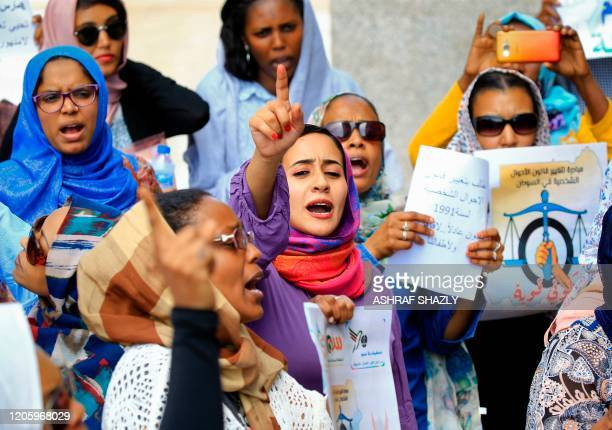 Women chant slogans during a demonstration calling for the repeal of family law in Sudan, on the occasion of International Women's Day, outside the...
