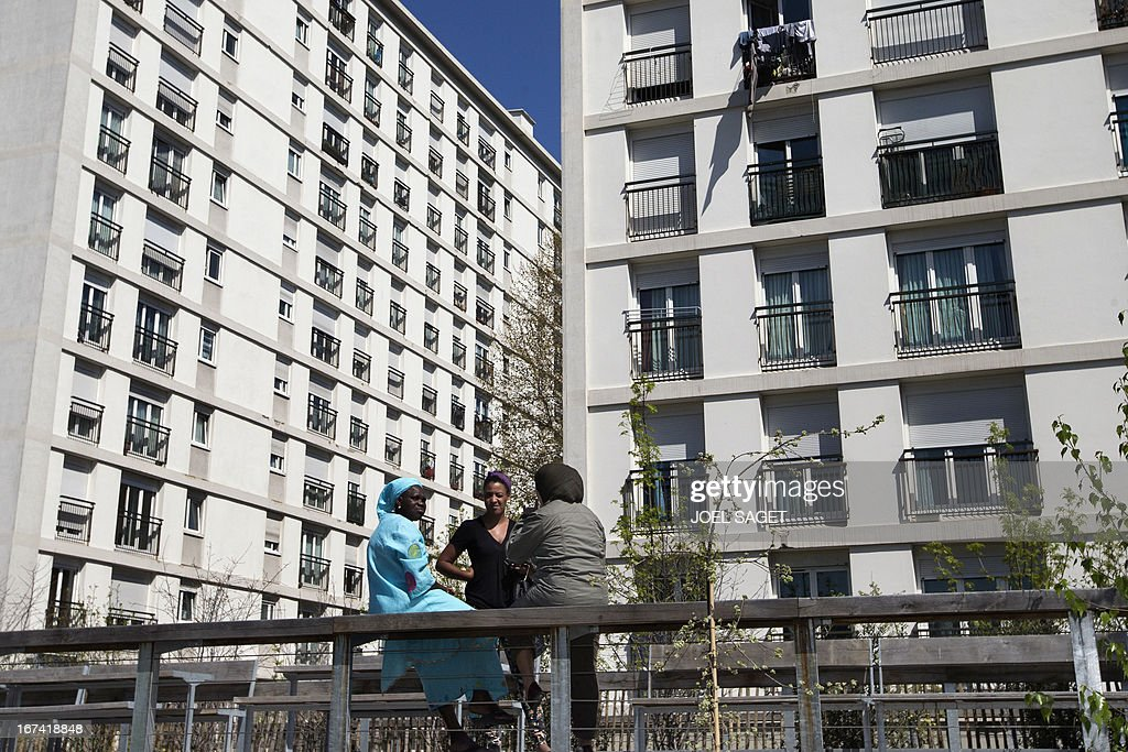 Women chat near an apartment building at Place de Vanves in Paris on April 25, 2013.