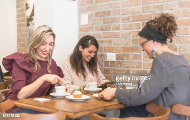 Women chatting and having fun in a coffee shop