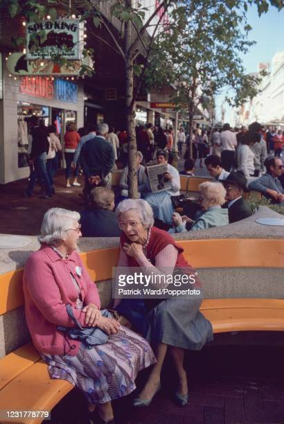 Women chatting at an outdoor shopping mall in Perth, Western Australia, circa October 1984.