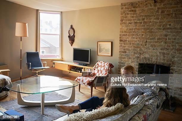 Women chatting in living room