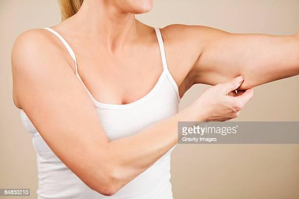 Women checking arm skin