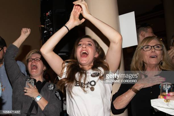 Women cheer as they watch election results at the Democrat Election Night Party held at The Driskill Hotel on November 6 2018 in Austin Texas Control...