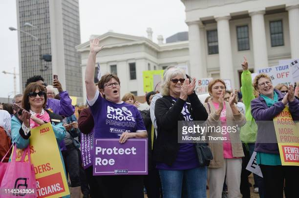 Women cheer during a protest rally over recent restrictive abortion laws on May 21 2019 in St Louis Missouri Rallies were planned across the nation...