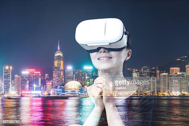 women Child with a virtual reality game