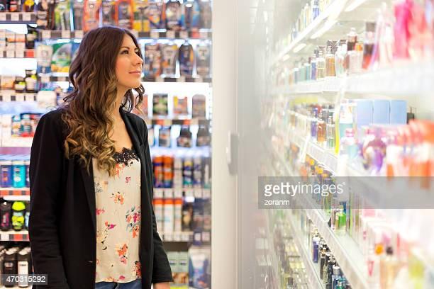 Women choosing parfume in store