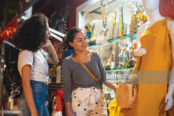 women choosing the drees - pop up store stock pictures, royalty-free photos & images
