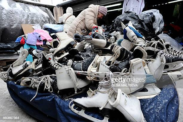 Women chose figure skates at a street second hand market in St Petersburg on December 28 2014 Deep recession skyrocketing prices and a fragile...