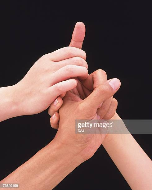 Women clasping mans hand