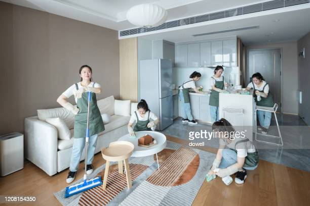 women cleaning house  at multi-tasking - 専業主婦 ストックフォトと画像