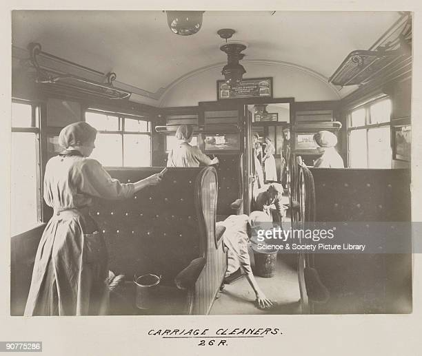 Women cleaning the inside of a railway carriage at Doncaster carriage works At this time there were fewer women working on the railways than men and...