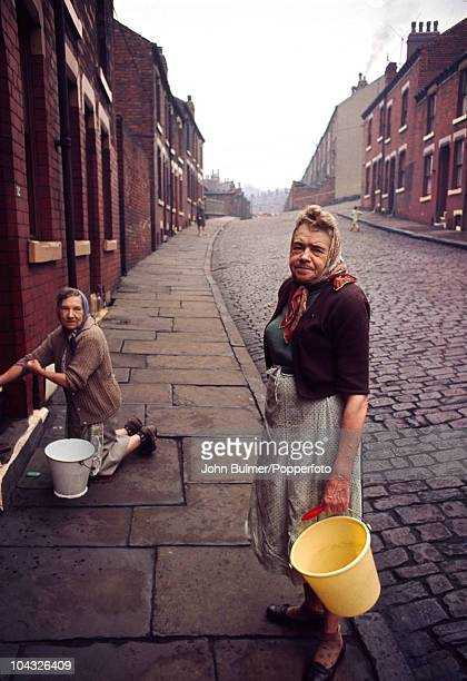 Women cleaning their front steps in Leeds circa 1977