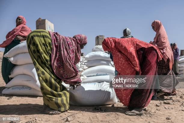 Women collect supplies brought by the World Food Programm at the Internally displaced person camp of Farburo in Gode near Kebri Dahar southeastern...