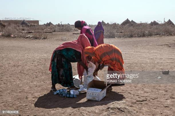 Women collect supplies brought by the World Food Programm distribution at the Internally displaced person camp of Farburo in Gode near Kebri Dahar...