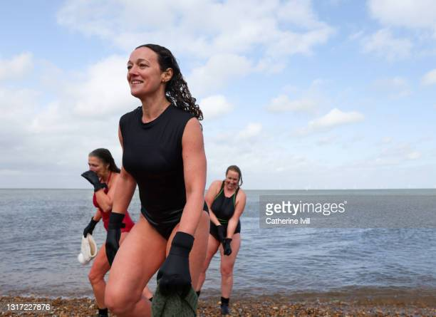 women come out of the water after open water swimming - showus stock pictures, royalty-free photos & images