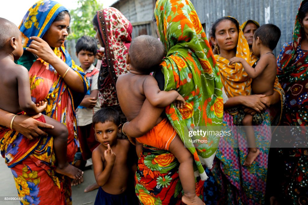Women come to receive relief from a local rulling party MP at Jamtola, Sariakandi, Bogra, Bangladesh 17 August 2017. According to authorities, floods caused by heavy rainfall lashing Bangladesh during the past week have left at least 56 people dead. Affected people are waiting to get more relief as they are in shortage of food and drinking water in the shelter centers.