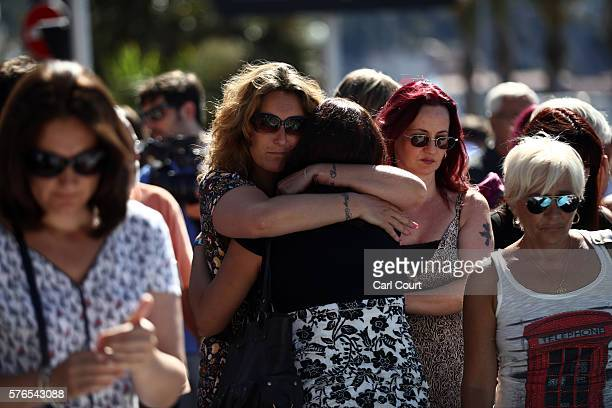 Women comfort each other next to tributes on the Promenade des Anglais on July 16 2016 in Nice France Five people believed to be linked to the man...