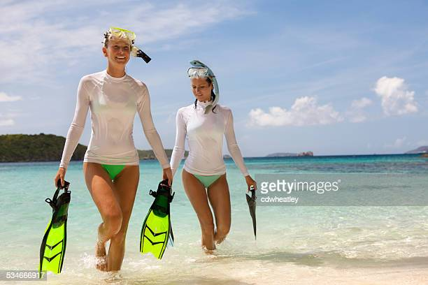women coming back from a snorkel adventure in the caribbean - snorkeling stock pictures, royalty-free photos & images