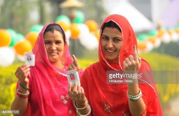Women coming out after casting their vote at Dilkusha Kendriya Vidyalya polling centre on February 19 2017 in Lucknow India The third phase of...