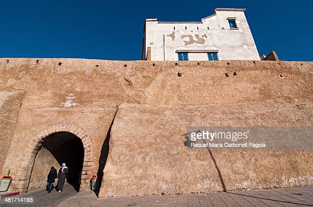 Women coming out the walled Portuguese city
