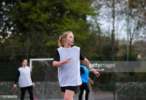 women compete in a football match - menopossibilities stock pictures, royalty-free photos & images