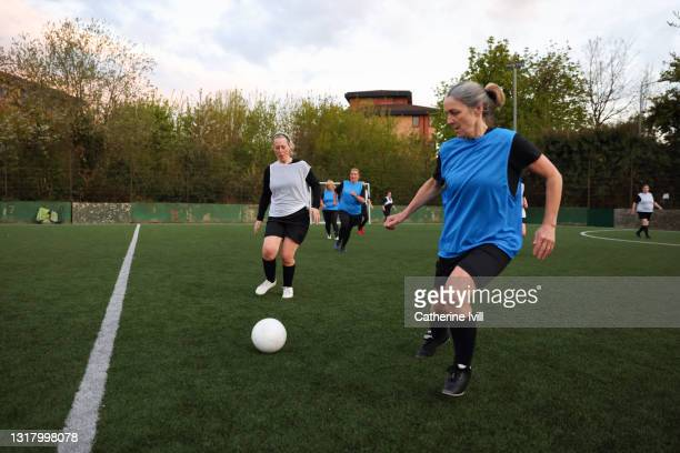 women compete in a football match - football stock pictures, royalty-free photos & images