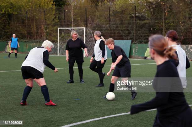 women compete in a football match - showus stock pictures, royalty-free photos & images