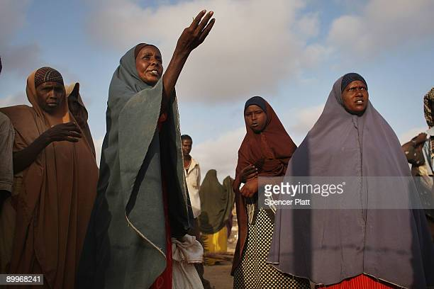 Women complain about the meager food rations while waiting in line at a United Nations food distribution center in Dadaab, the world�s biggest...
