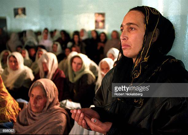 Women congregate in a central Kabul hall December 10 2001 to celebrate and honor the death of Northern Alliance leader Ahmed Shah Massoud killed...
