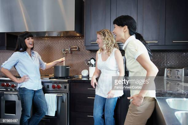 Women cooking and laughing