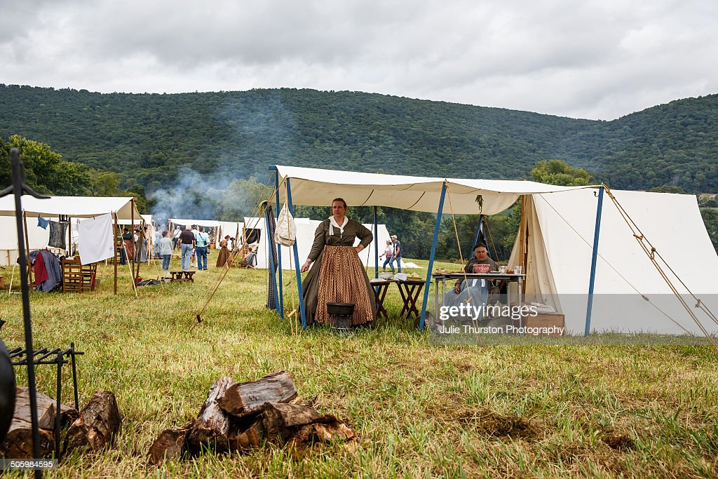 Women Cooking and Living at a Family C&site in Tents During the 150th Anniversary of the & Battle Re-Enactments Pictures | Getty Images