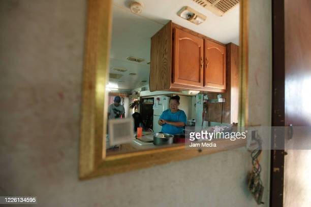 A women cooking inside of circus trailer on May 20 2020 in Queretaro Mexico As nonessential activities are not permitted during stage three of the...