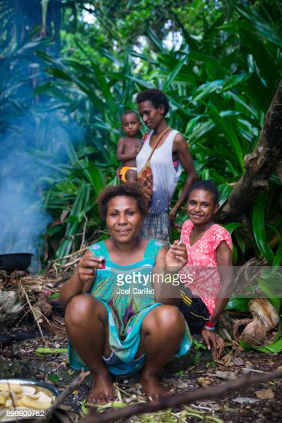 Women cooking out in Madang, Papua New Guinea