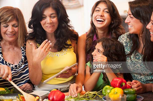 Women cooking together in kitchen