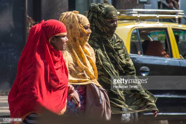 Women cover their face with dupatta to protect from the heat at Dadar on February 26 2020 in Mumbai India