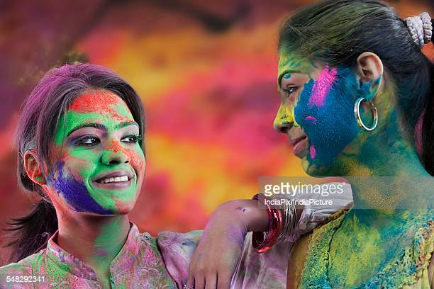 women covered in holi colours - new generation stock pictures, royalty-free photos & images