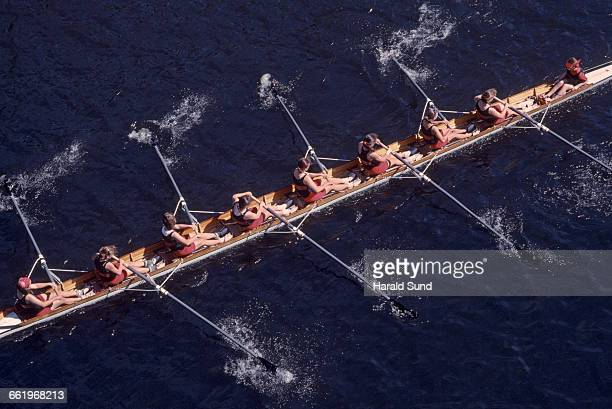 8 women crew competitive rowing race.