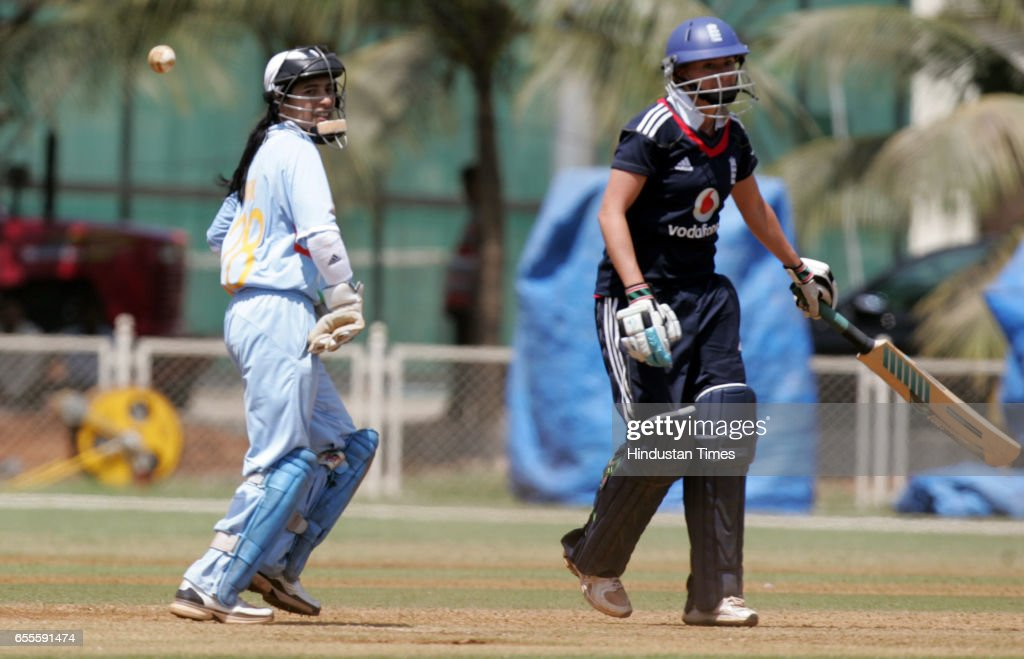 Women Cricket - India WK Sulakshana Naik and England batswoman Marsh the first T20 match between India and England Women's team at MCA Recreational Centre ground at Bandra-Kurla Complex.