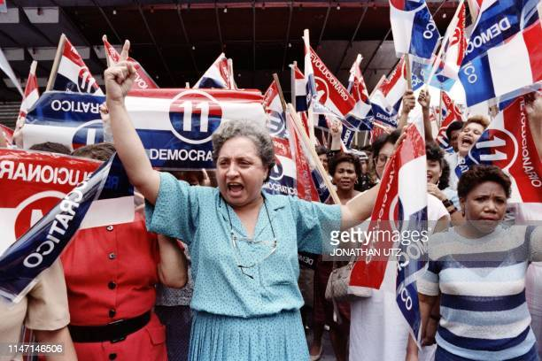 Women crie a pro-grovernment slogan during a demonstration supporting the leadership of military strongman General Manuel Antonio Noriega on June 15,...