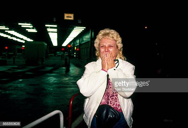A women cries with joy as she crosses to freedom from East Berlin to the west through Checkpoint Charlie on the night of November 9 1989 when the...