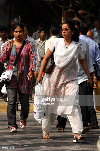 Women cross a street in Mumbai India on Thursday Nov 29 2007 India's economy grew last quarter at the slowest pace since 2006 signaling the central...