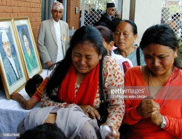 Women cry after signing in the condolence book at Narayan Hity Royal Place in Kathmandu 06 June 2001 Thousands of men women and children queued all...