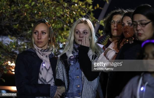 Women cry as thousands of people light over 2,500 candles for domestic violence victims during the traditional commemorative ceremony held to draw...