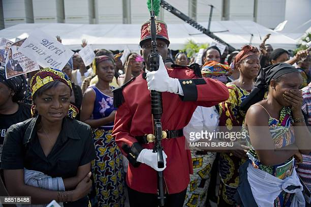 Women cry during the funeral of late Gabonese President Omar Bongo on June 16 2009 in Libreville Bongo died in Barcelona from cancer on June 8 2009...