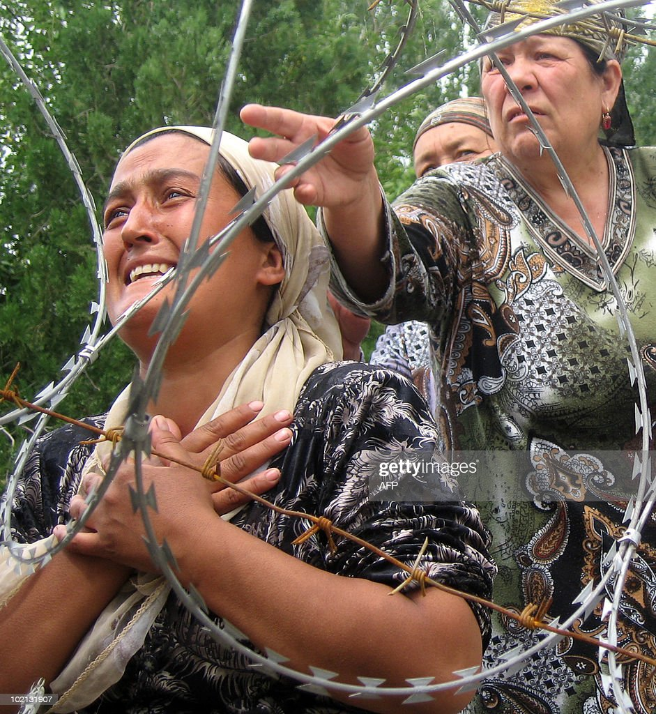 Women cry in Yorkishlok on June 15, 2010 on the border between Kyrgyzstan and Uzbekistan. Thousands of ethnic Uzbek refugees remain stranded in Kyrgyzstan, unable to enter Uzbekistan and unwilling to return to their homes in Kyrgyzstan after days of deadly conflict raging across the south of the ex-Soviet state. A shattered Kyrgyzstan on June 16, 2010 started three days of national mourning for nearly 180 killed in ethnic bloodletting as a US envoy was due in the region to deal with a growing humanitarian crisis.
