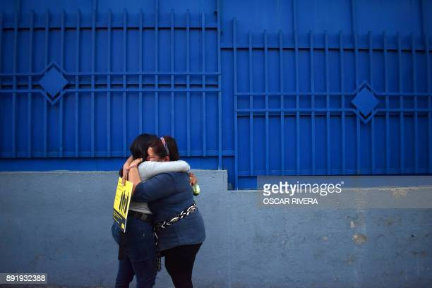 Women cry outside the Isidro Menendez Judicial Center after a hearing held to review the sentence handed down to Theodora de Carmen Vasquez in 2008...
