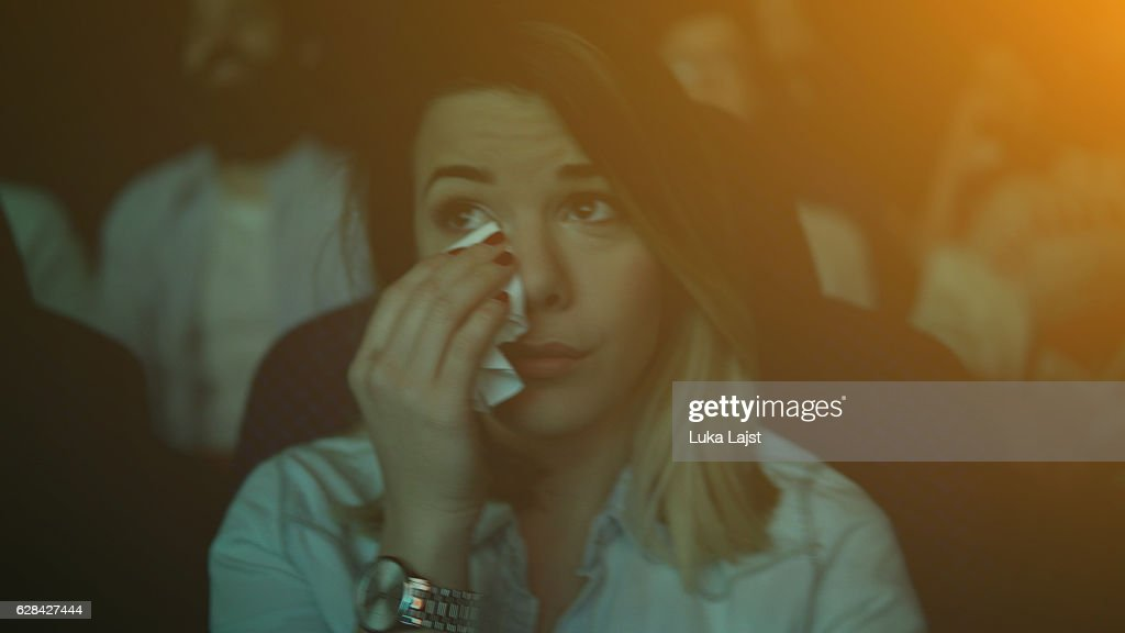 Women crying while watching movie in a cinema hall : Foto de stock