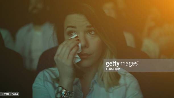women crying while watching movie in a cinema hall - handkerchief - fotografias e filmes do acervo